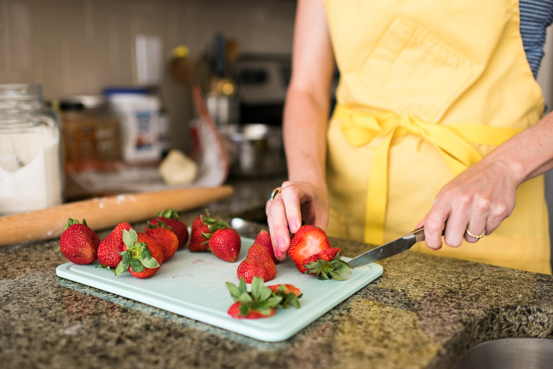 denver small business photography cutting strawberries