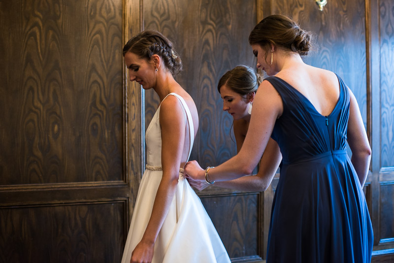 denver athletic club wedding photography sisters helping bride