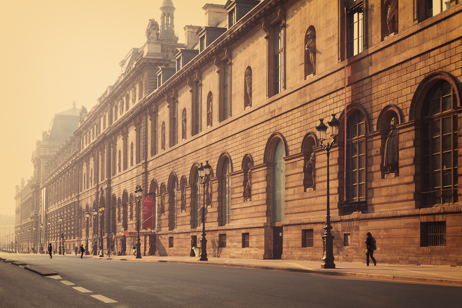 Photograph of the outside of the The Louvre Museum in Paris, in the early morning