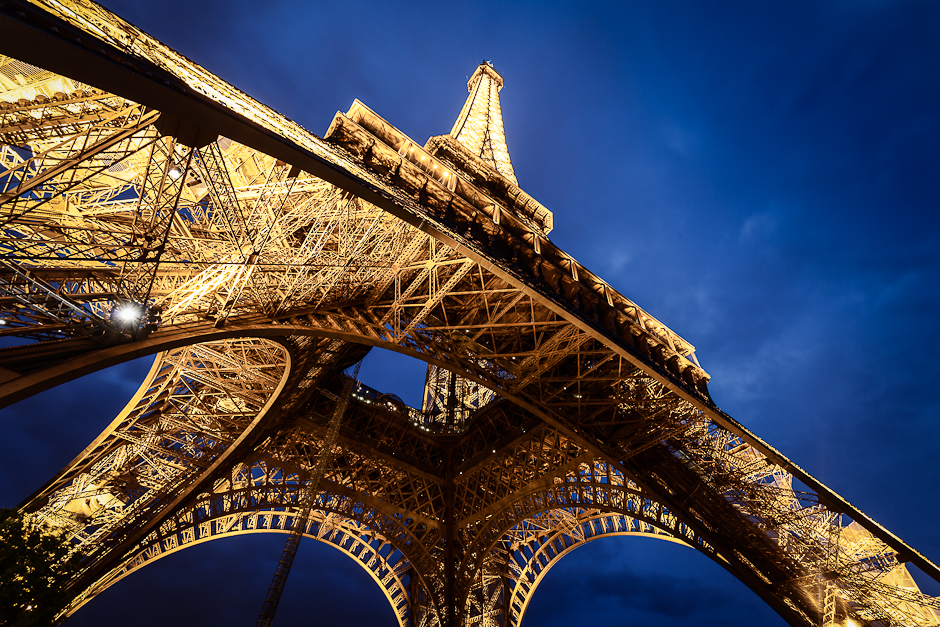 Photograph of The Eiffel Tower in Paris from below just after sunset in the blue hour