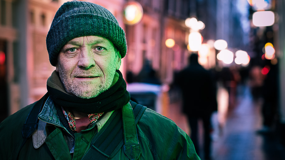 Portrait of a man in an Amsterdam street in the evening