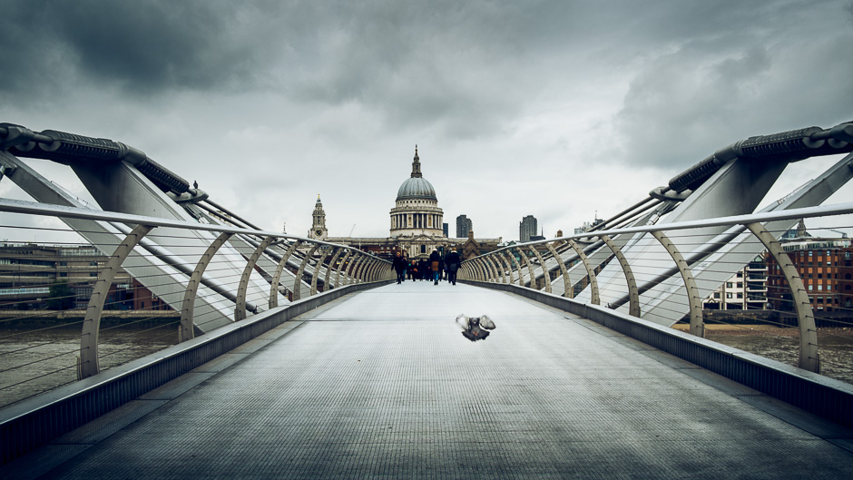 A photograph of the the London Millennium Footbridge on a cloudy day