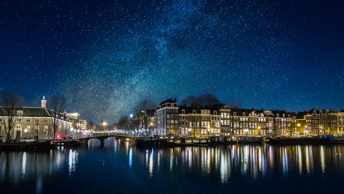 The stars of the Milky Way over Amsterdam, on the river Amstel