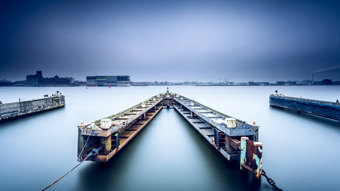 A long exposure image of a ferry doc in Amsterdam