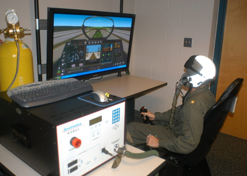070216-N-6247M-009 Whidbey Island, Wash. (Feb 16, 2007) Ð Lt. Cmdr. James McAllister, from San Diego, Calif. sits in the simulator during a test flight using the new Reduced Oxygen Breathing Device (ROBD). The ROBD is a portable device that delivers a mixture of air, nitrogen and oxygen to aircrew, simulating any desired altitude. Combined with a flight simulator the ultimate effect replicates an altitude induced hypoxia event. McAllister is the Director of the Aviation Survival Training Center at Whidbey Island. U.S. Navy photo by Mass Communication Specialist 1st Class Bruce McVicar (RELEASED)