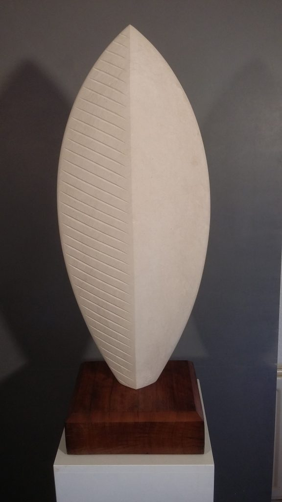 Stone shield sculpture in Portland Stone.