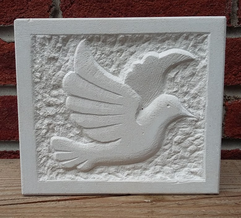 Stone carving of Dove