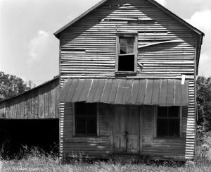 5-22-1982 Old house and store near Fayetteville Tennessee on H64-Linhof Technika V 4x5 camera-300mm Nikkor M lens-K2 filter-Ilford FP4 4x5 film-Kodak HC110B developer.