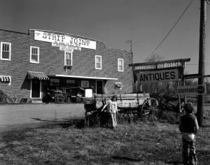 "3-9-1980 Strip Joint near Fruitland Missouri-Crown Graphic 4x5 camera-71/2"" Gundlack Krona lens-G filter-Ilford FP4 4x5 film-Edwal FG7 developer."