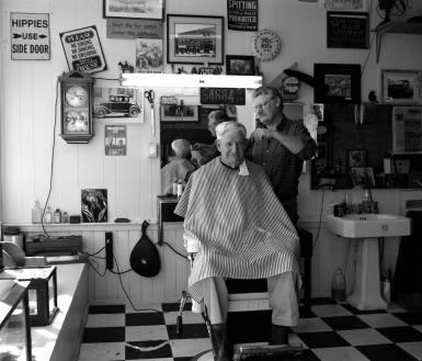 10-8-2015 Jim Lloyd Barber and Banjo Shop-Jim Lloyd cutting Eddie Lawson's hair-Rural Retreat Virginia-Pentax 6x7 camera-75mm lens-Ilford Delta 100 120 film-PMK Pyro developer.