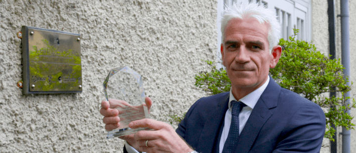 John O'Brien with his firm's Public Sector magazine award