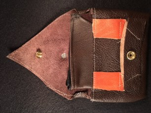 Geuine leather sewn into a attractive catch. Inside is a zippered coin uchj. The flap is secured with a heavy duty snap. C1101 $15.00