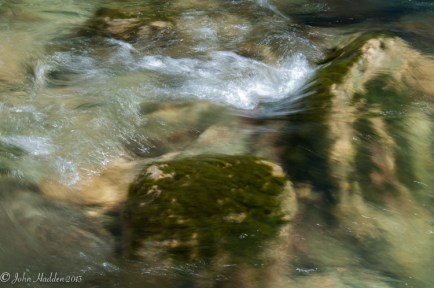 Water and moss covered boulders in lower Huntington Gorge
