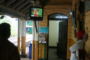 Railway workers watch a World Cup match at the Ella train station.