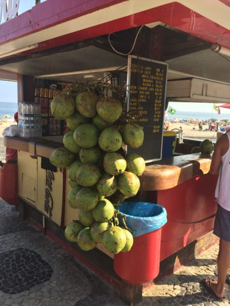 Coconut stands serve chilled coconuts with a straw.