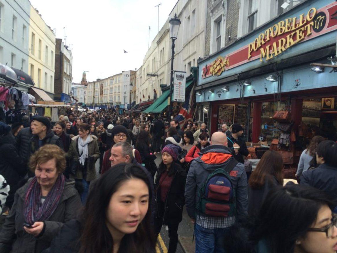 Portobello Road Market, specializing in antiques, is one of 73 public markets in London.