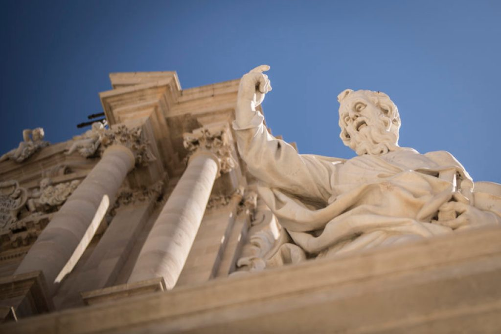 Statue on Ortygia's Duomo which was built atop a 5th century BC Greek temple. Photo by Marina Pascucci.