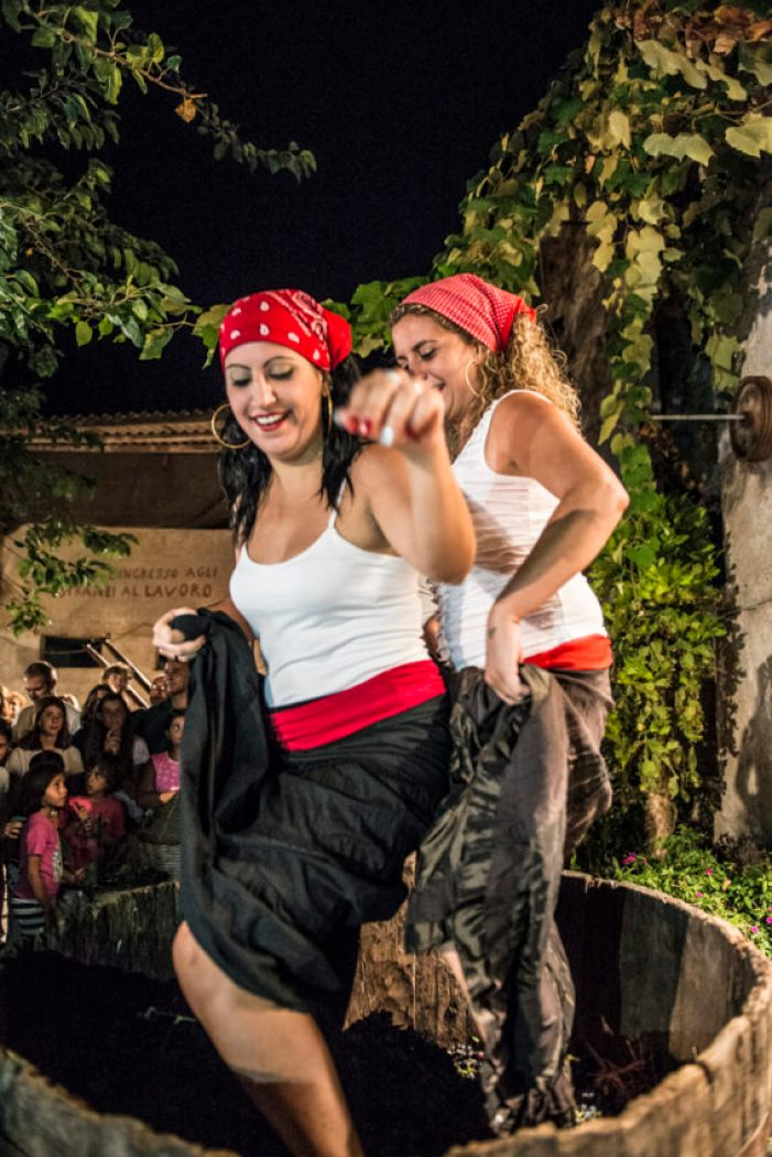 Women stomping grapes in Avola, home of Sicily's famous Nero d'Avola wine. Photo by Marina Pascucci.