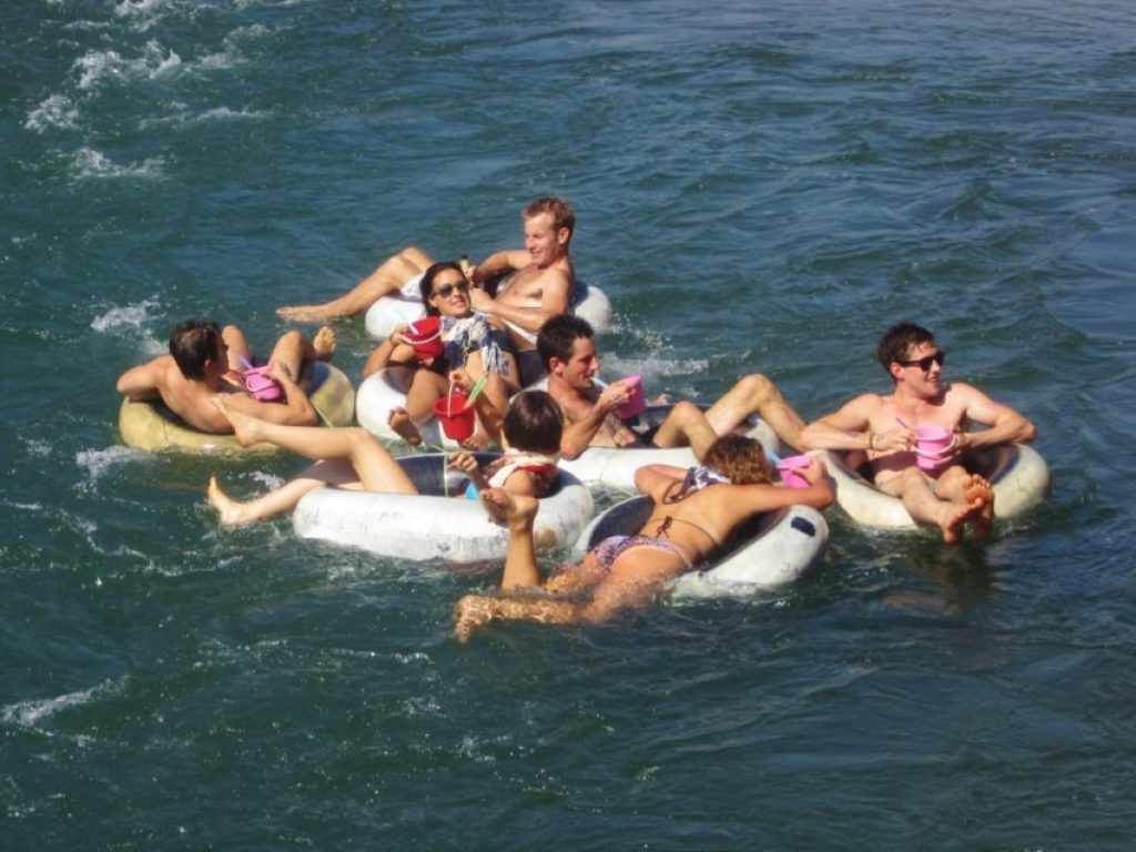 A file photo of partying while tubing in Vang Vieng. Those are buckets of iced whisky and mixers they're holding.