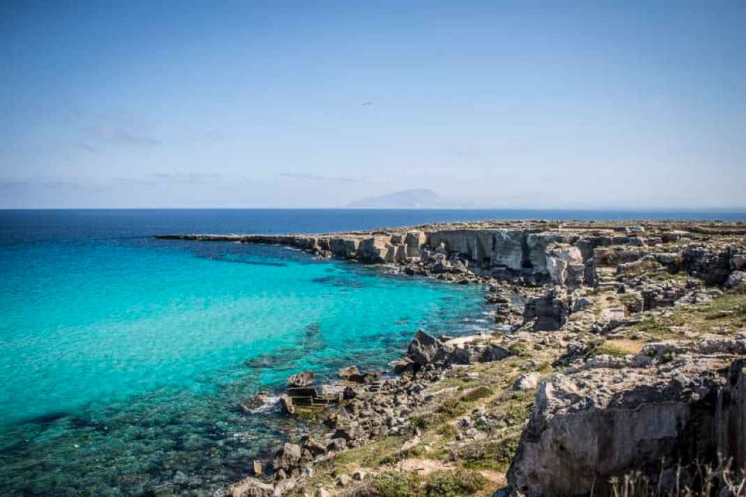 Favignana's Cala Rossa, once the site of a great Roman victory in the 3rd century BC, now sport's some of clearest water in the world. Photo by Marina Pascucci