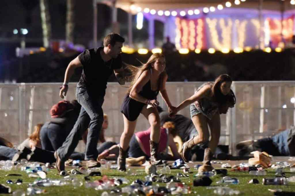 Concert goers run for cover Sunday in Las Vegas where a gunman killed 59 people and injured more than 500.