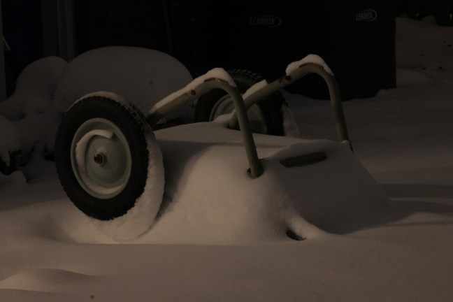 photo of wheelbarrow covered in snow