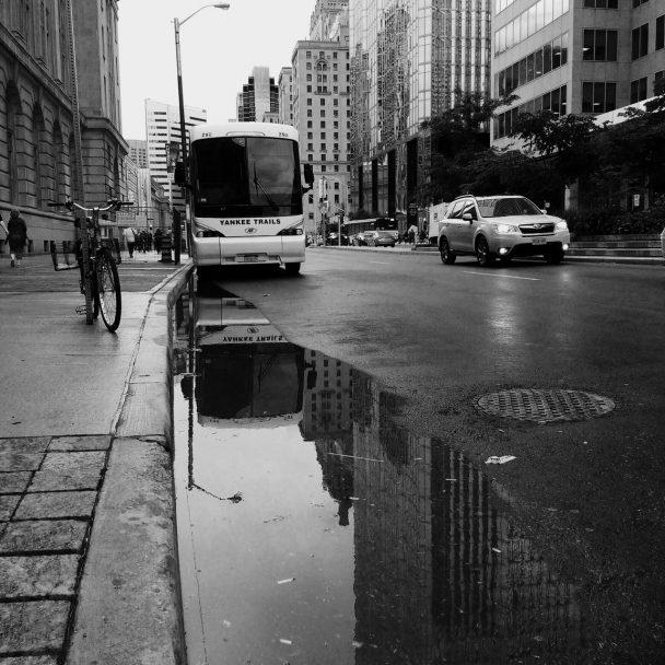 Black and white tour bus in Toronto Ontario