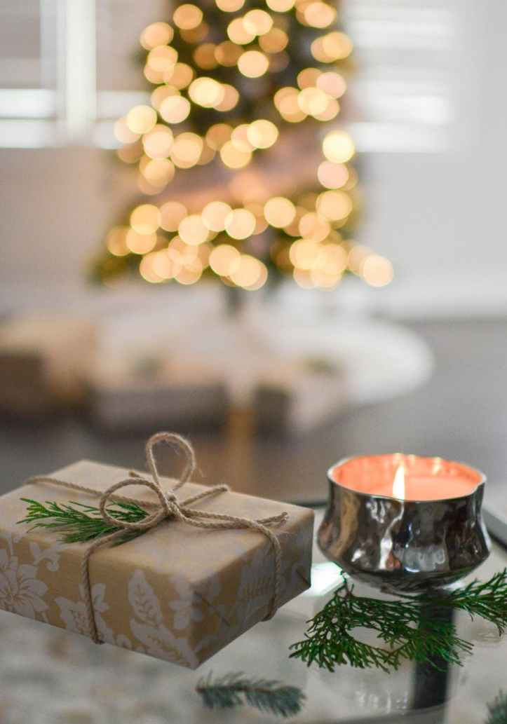 close up photography of gift besides candle