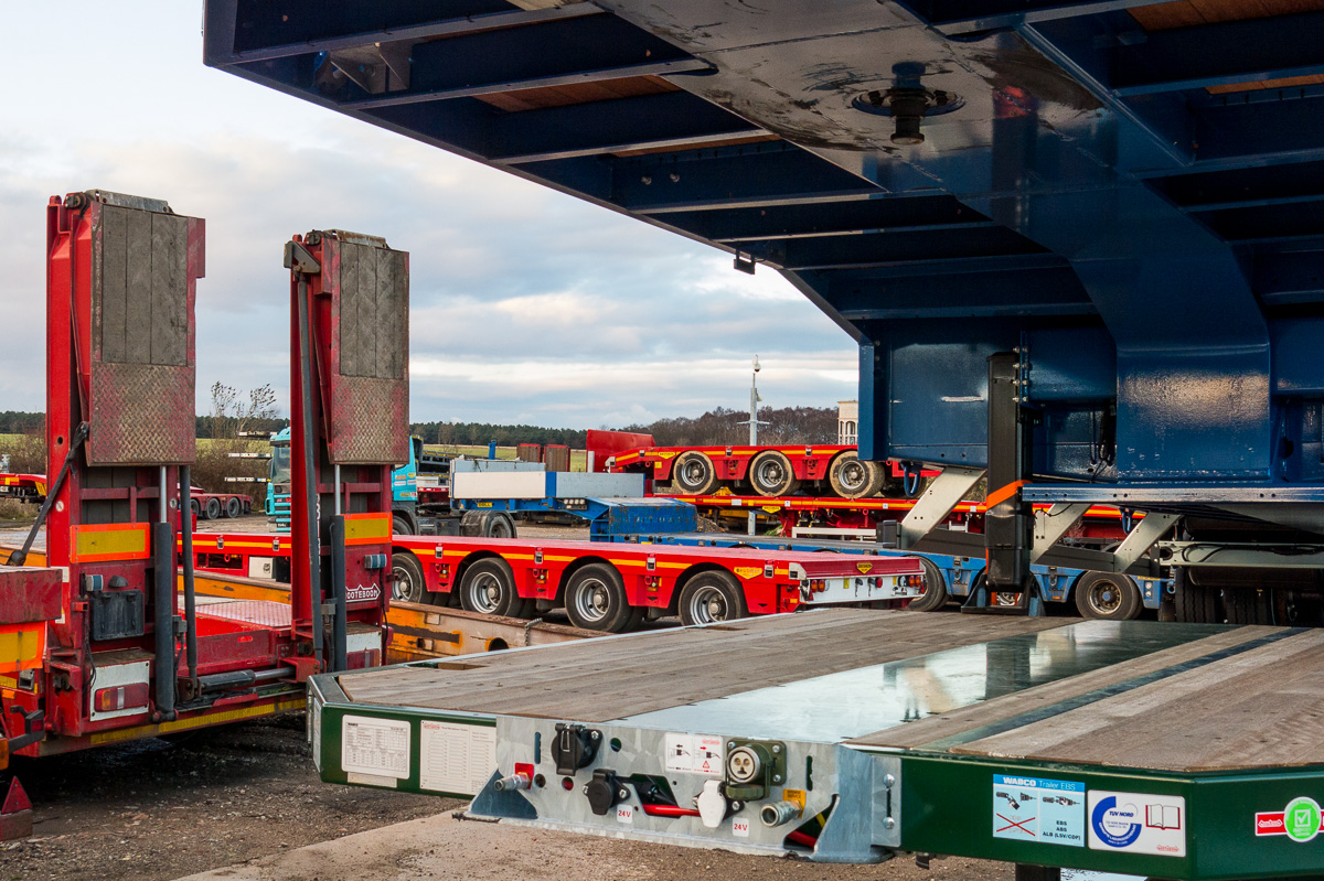 Shows large fleet of semi low loader extendable HGV trailers