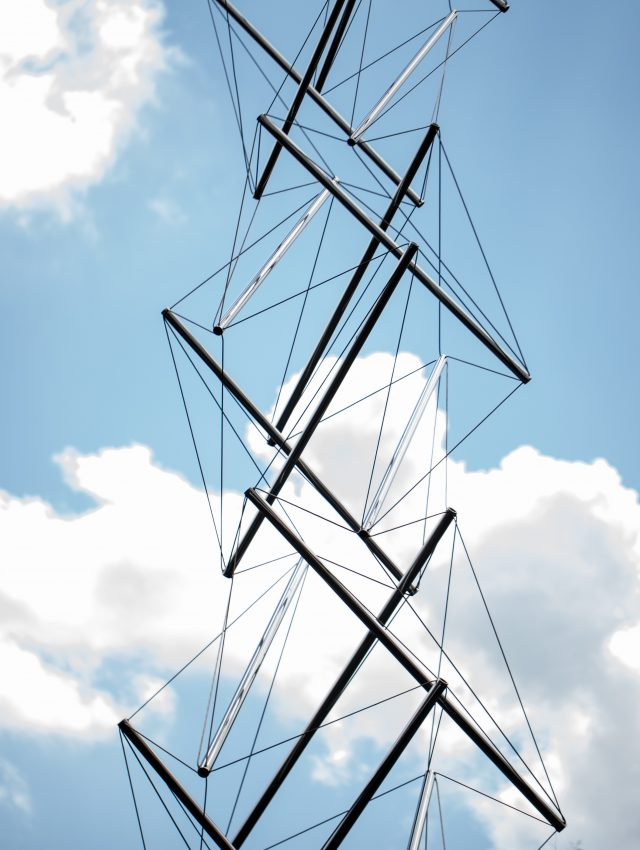 A closeup of a scuptue by Kenneth Snelson on display in  Big Lake at the New Orleans Museum of Art.