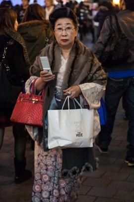 60.05 Woman shopping in Dotonbori