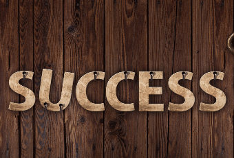 SUCCESS letters nailed to a wall