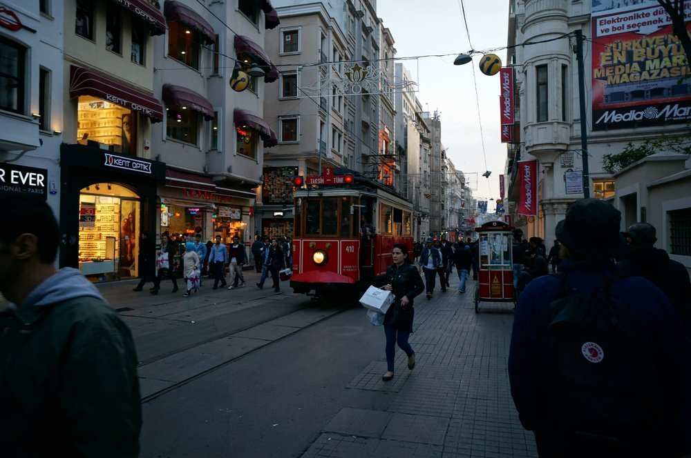 The chaos of Istiklal with the tram in the background.