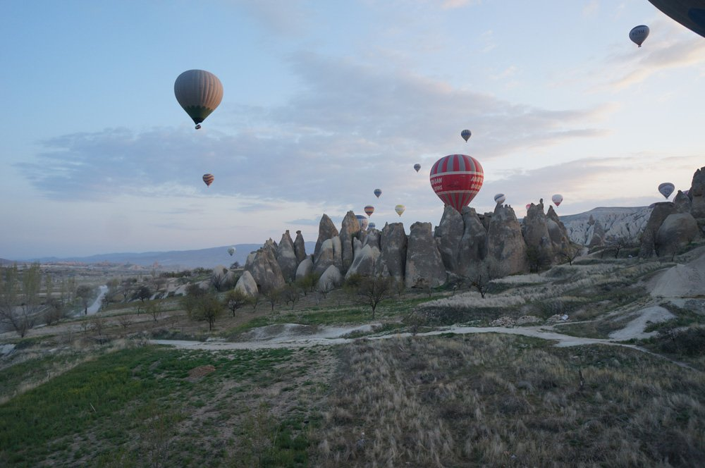 No better way to see the chimney rock formations in Cappadocia than by hot air balloon in the morning.