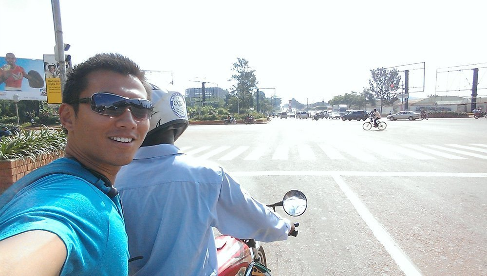 Riding on the boda boda with my guide, Michael.