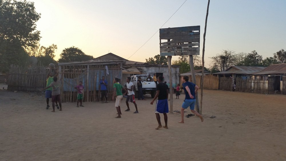 Jesse playing basketball with the locals.