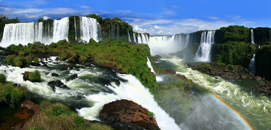 Routinely ranked as one of nature's top wonders, Iguazu falls lies on the border between Brazil and Argentina and can be visited on both sides. Both countries are incredible deals at the moment for the dollar!
