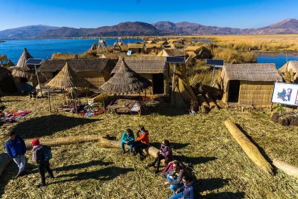 Uros people floating islands lake titicaca puno copacabana