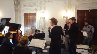 Isabel, Raphael and Ecce conductor Ryan McAdams working with a workshop fellow