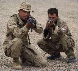 Marine Lance Cpl. Ben Rosenberg, 31, from Austin, Texas, trains Iraqi Civil Defense Corps soldier Yassir, 22, who fought against U.S. troops when they invaded Iraq one year ago.