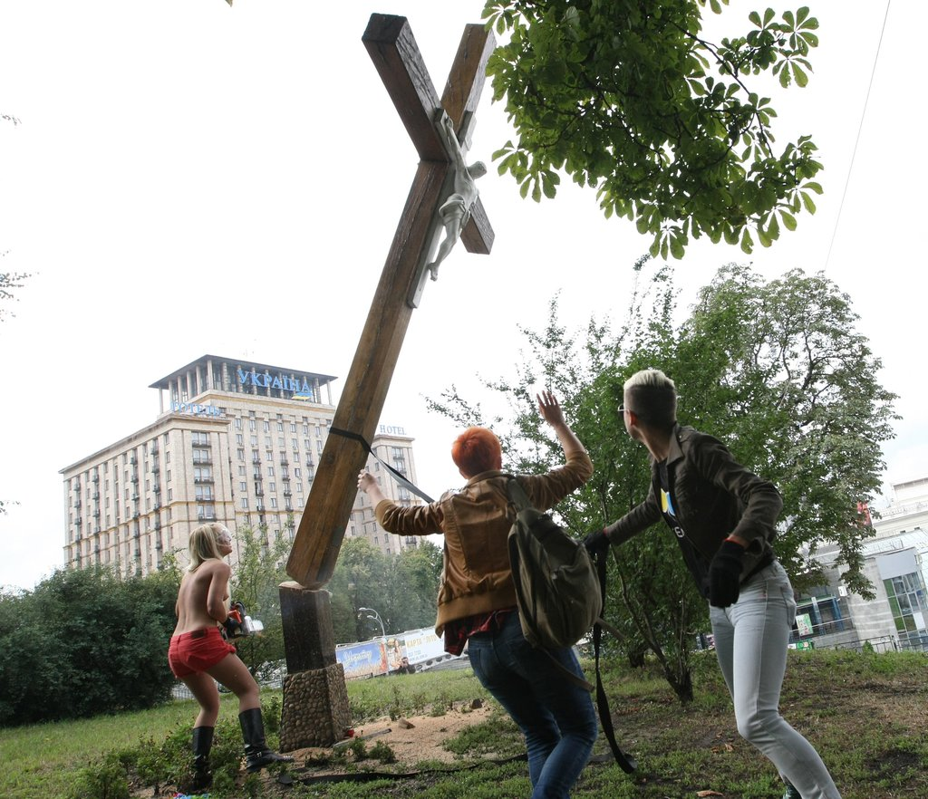 """Femen"" desecrating crosses in Kiev, Ukraine."