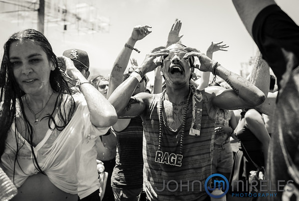 Man dancing to electronic music at Coachella 2013
