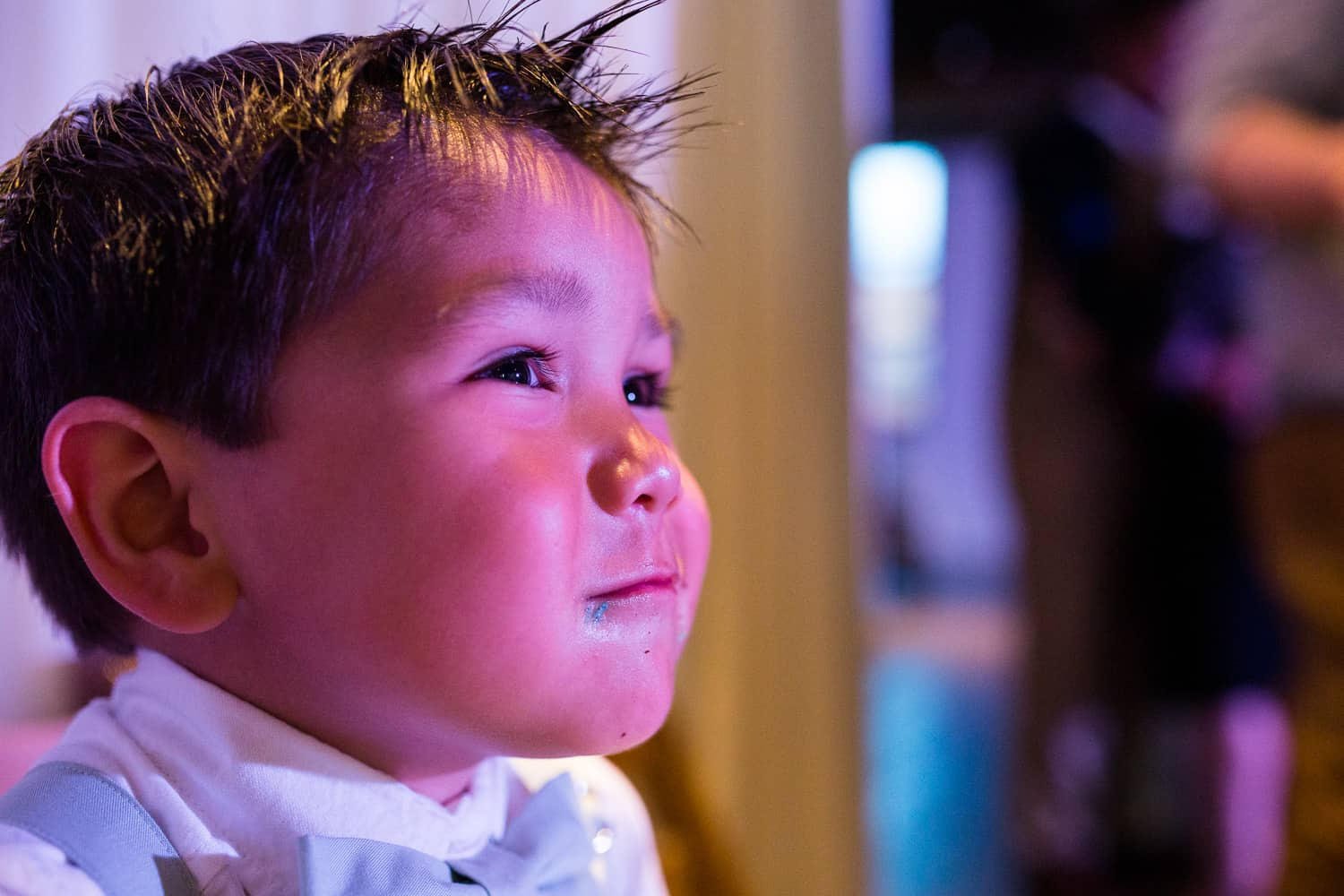 a close up photo of blue frosting on the ring bearers face.