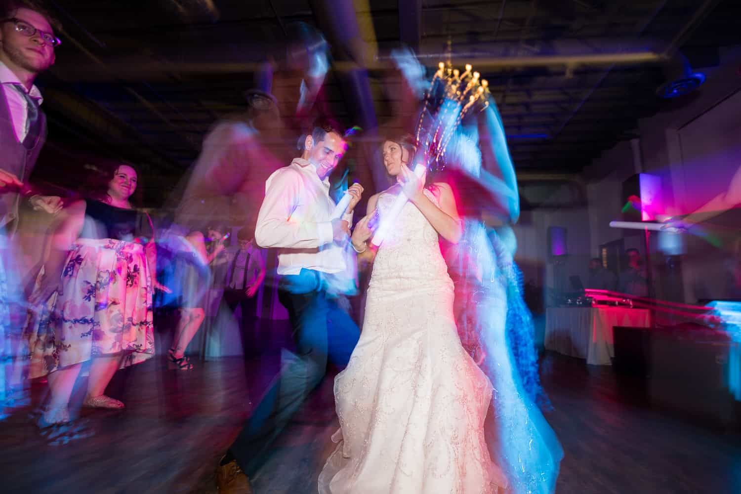 a long exposure photo on the dance floor with the bride double exposed.
