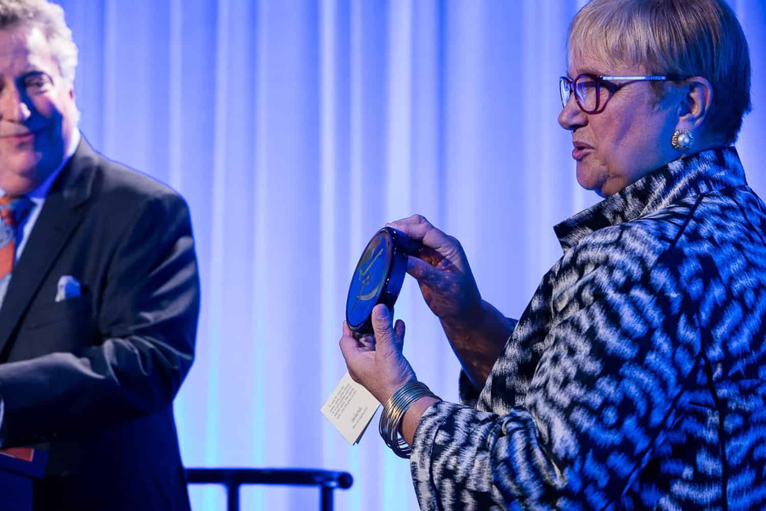 Photo of lidia bastianich accepting an award at wxxi event.