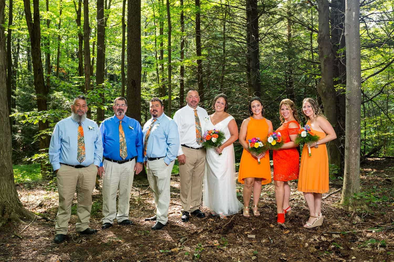 The wedding party wore orange at Paula's outdoor wedding at Luensman Overview Park on Thayer Hill.