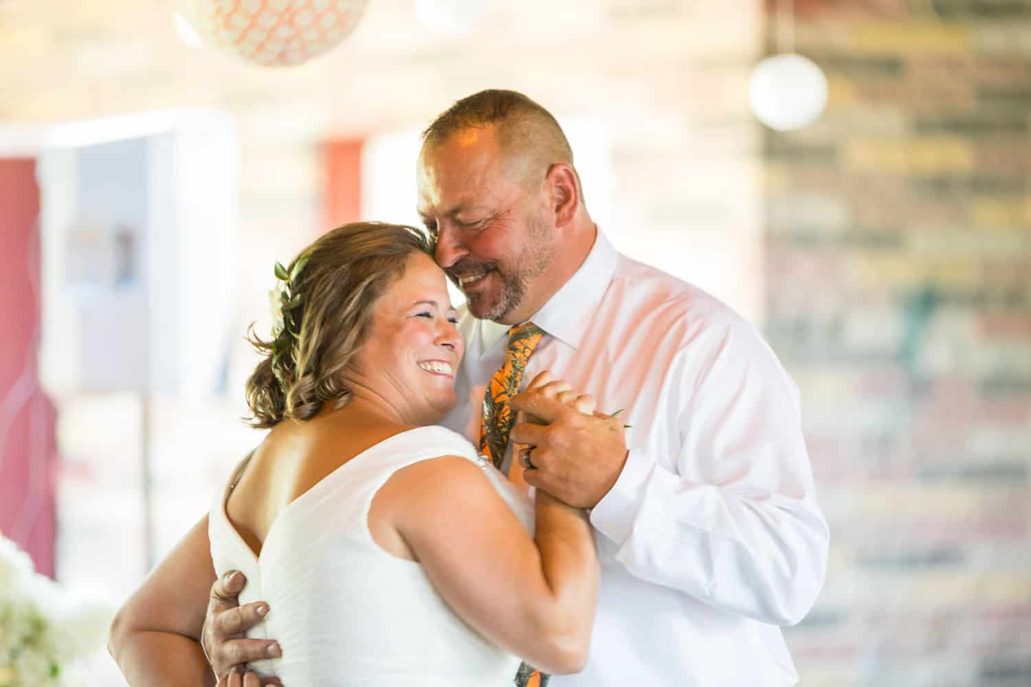 Paula and Dwayne share their first dance at their wedding at Point Gratiot Park.