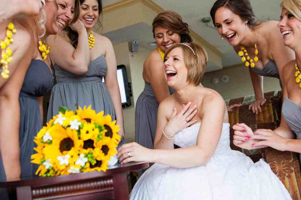 Amanda and her bridesmaides laugh at her Rochester wedding.
