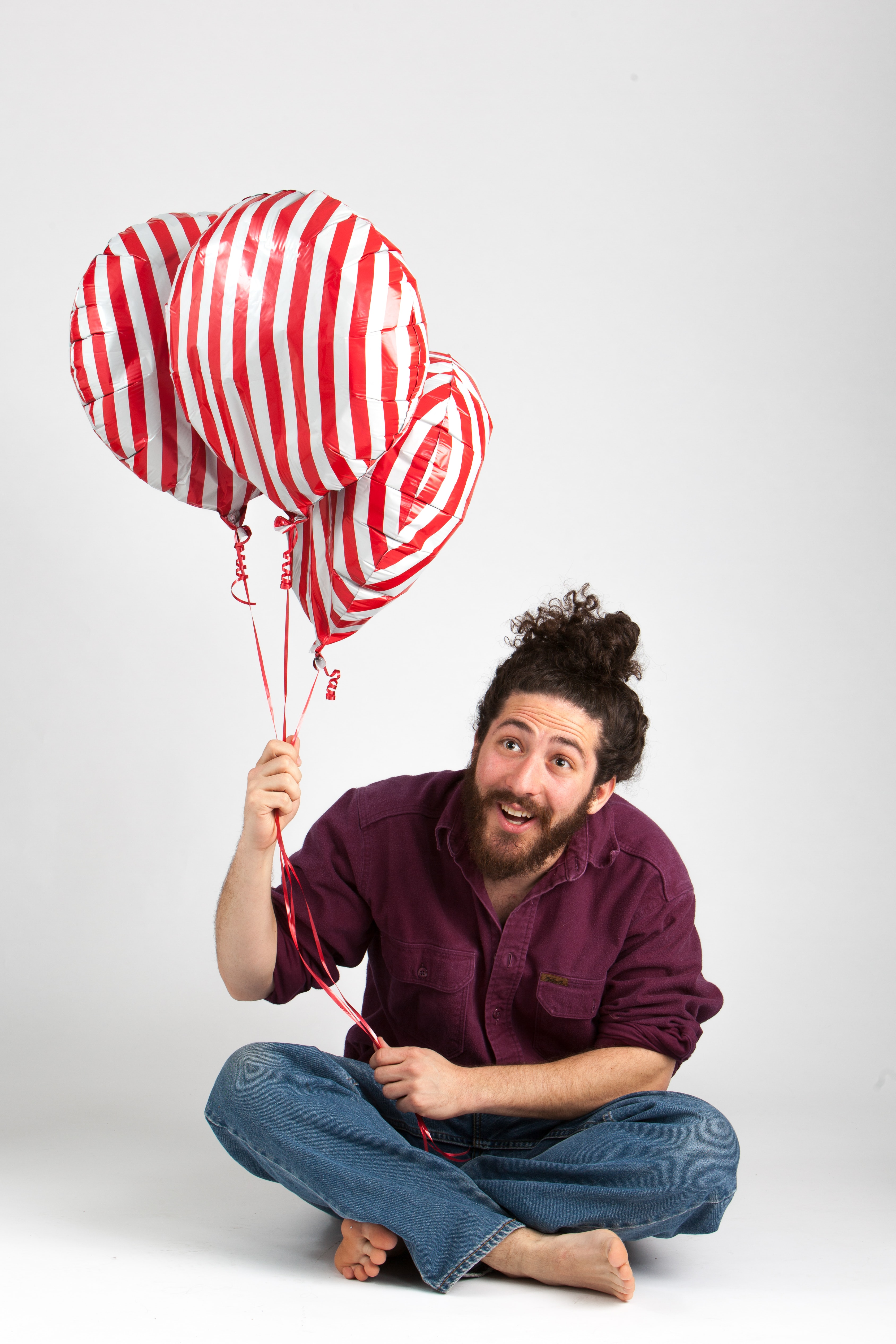 An acting headshot for a comedian with baloons.