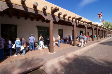 Native Americans selling their art outside the Palace of the Governors.
